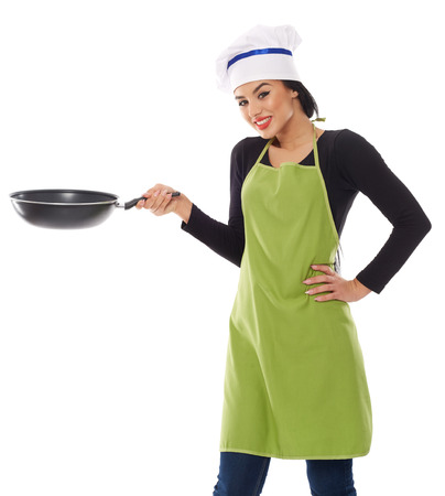 Cheerful latino woman cook with frying pan isolated on white
