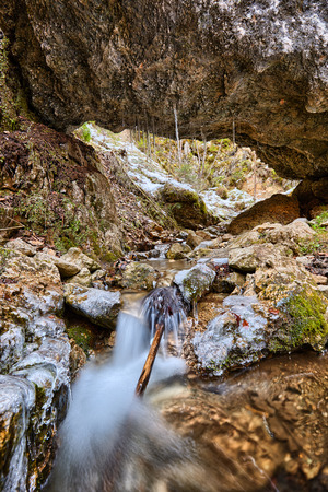 frozen creek: Frozen mountain creek flowing through the icy rocks