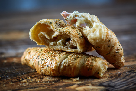 Delicious pastry filled with cheese and ham covered in sesame seeds