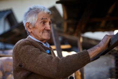 adult 80s: Rural old man smiling happy outdoor, closeup portrait