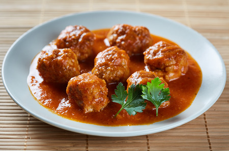 Beef and pork meatballs in tomato sauce on a plate