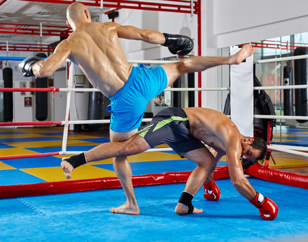 Kickbox fighters in the ring, during combat
