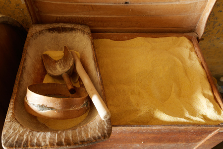 corn flour: Crate with corn flour and wooden kitchen utensils