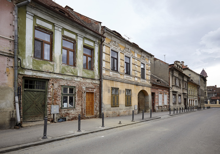 decrepit: An empty street and decrepit houses in an old town Stock Photo