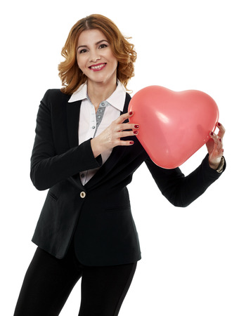attractive  female: Happy young businesswoman holding a heart shaped balloon