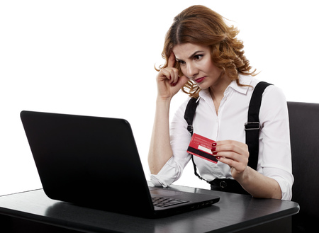 whether: Unsure businesswoman contemplating whether to use her credit card online
