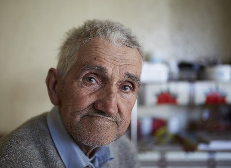 80 years: Closeup portrait of an 80 years old farmer indoor Stock Photo