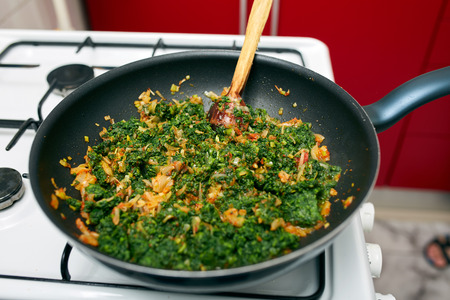 side dish: Preparing a delicious nettle porridge as side dish or vegetarian meal Stock Photo