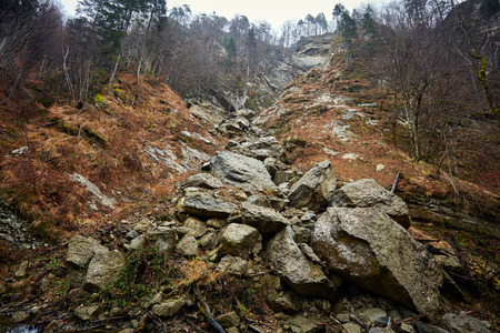 disrupted: Landscape with immense boulders disrupted by an avalanche in the mountains Stock Photo