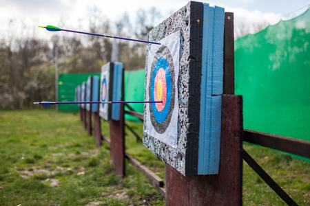 shootout: Targets at a bow shooting range with arrows in them