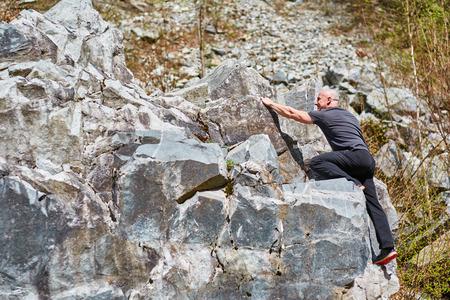 free climbing: Man free climbing on huge boulders on a mountain