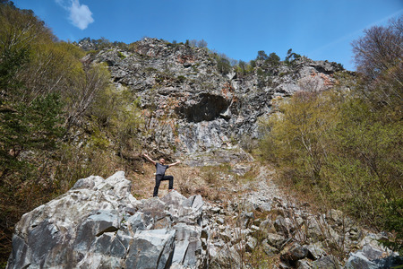 avalanche: Man posing at an avalanche after a huge rock broke from the mountain
