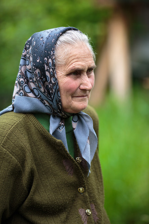 the seventies: Closeup of a farmer woman in her seventies outdoor with selective focus Stock Photo