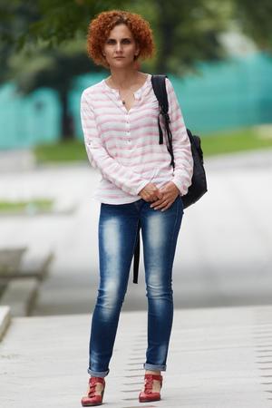 portret: Portret of an european redhead woman in urban environment