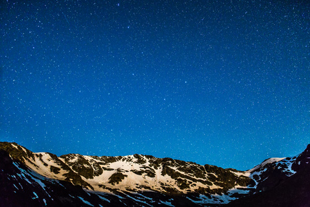 starlit sky: Landscape with mountain peaks and stars at midnight