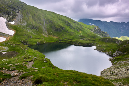 Landscape with lake Capra in Romanian Carpathian mountains