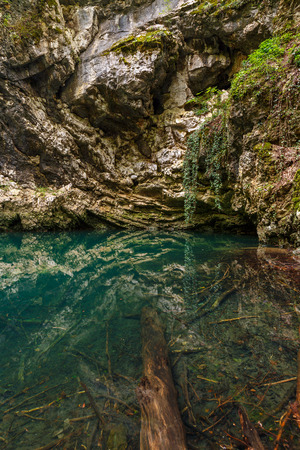 hydrological: Lacul Dracului in Romania, a lake formed after cave ceiling collapsed