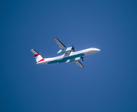 Propeller passanger airplane against clear blue sky