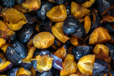chutney: Closeup of plums sliced in quarters to make jam or chutney