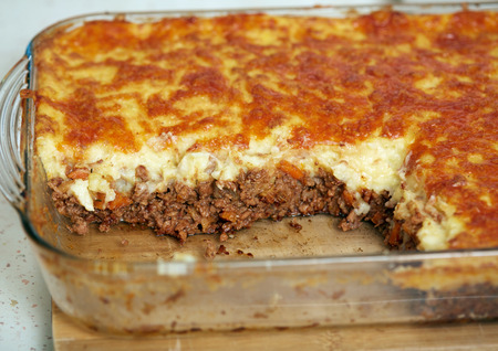Glass casserole with cottage pie, British recipe Stock Photo