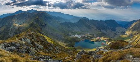 Aerial view of Balea Lake in Romanian Carpathians between mountain ranges
