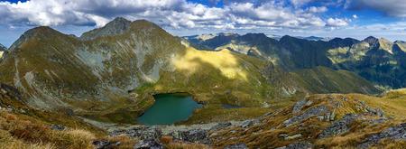 Landscape with Fagaras mountain range and Capra glacial lake in Romania Stock Photo