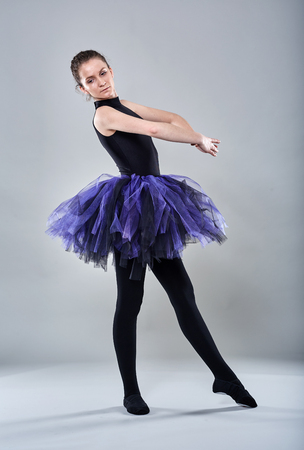 ballerina tights: Young ballerina in various postures on gray background