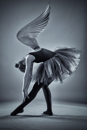 choreographic: Conceptual image of a ballerina with wings spread in monochrome toned