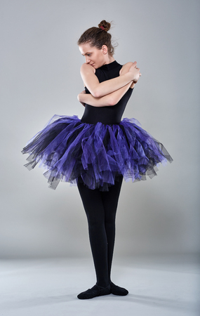 choreographic: Young ballerina in various postures on gray background