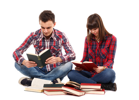 Teenage couple studying together, isolated on white background