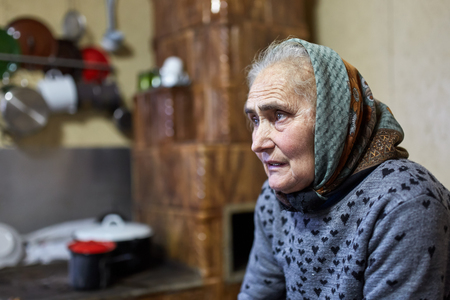 Senior farmer woman indoor in her house photo