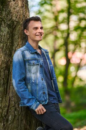 Handsome  teenage boy portrait in the forest park Banque d'images