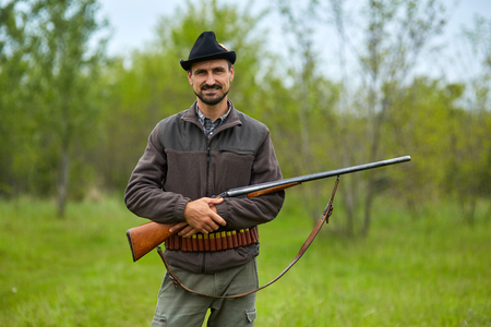 Hunter with a double barrel shotgun in the forest Stock Photo