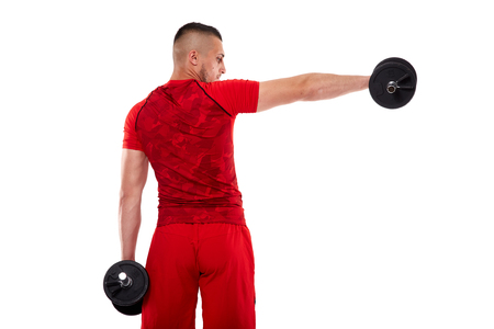Young man training deltoids with dumbbells isolated on white