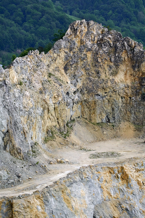 Landscape with a large stone quarry in full development Stock Photo