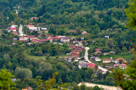 Aerial landscape shot of a village between mountains