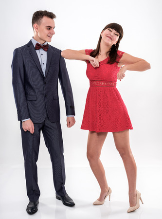 Teenage couple dressed in formal party clothing, dancing Banque d'images
