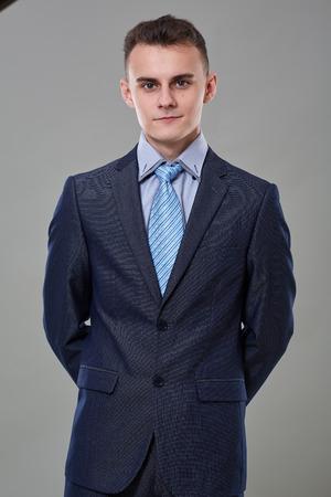 Young man in classic business suit, studio portrait