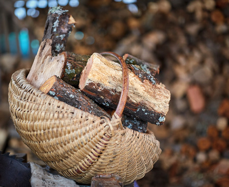 Basket with firewood with selective focus outdoor