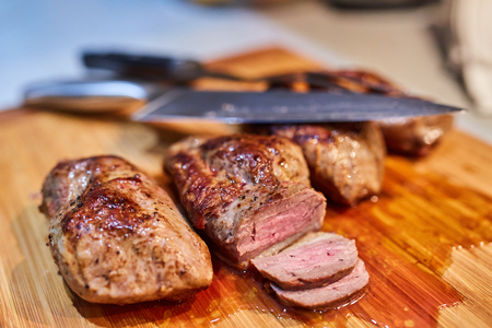 Juicy duck breast steak sliced on a wooden board Banque d'images