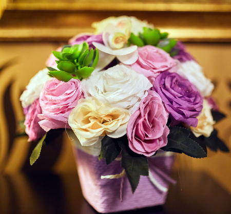 Closeup of a bouquet of artificial flowers indoor Banque d'images