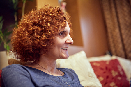 Closeup of a middle aged redhead woman indoor