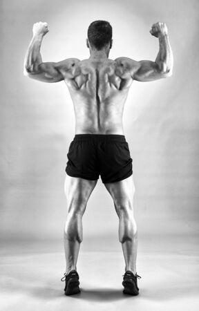 Fitness model portrait on gray background, studio shot 写真素材