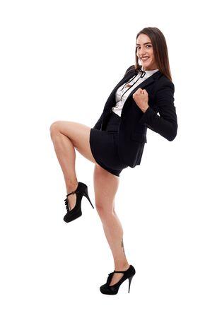 Femme d'affaires gaie et réussie célébrant ses accomplissements Banque d'images