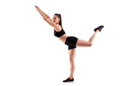 Young athletic woman posing as fitness model on white background 版權商用圖片