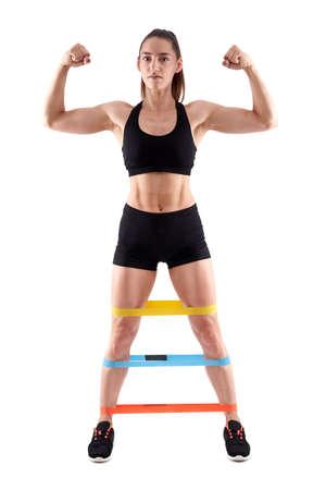 Athlete lady doing workout with elastic band 版權商用圖片
