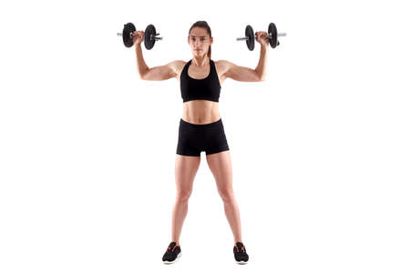 Young hispanic athletic woman working out with dumbbells, full length on white background