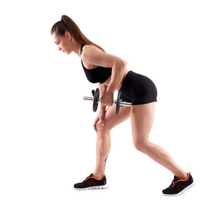 Young hispanic athletic woman doing rows with dumbbells, full length on white background