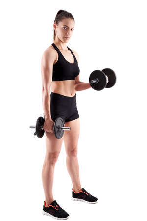 Young hispanic athletic woman working out with dumbbells, full length on white background Foto de archivo