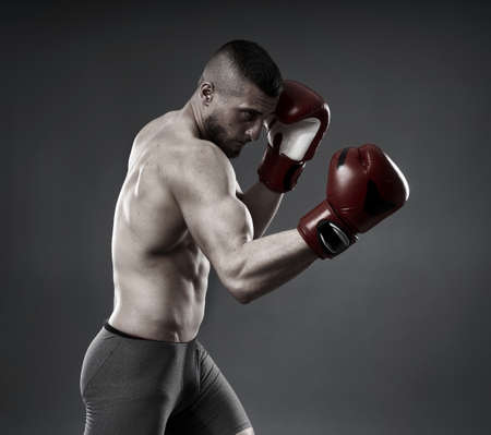 MMA fighter training, studio shot isolated on gray background